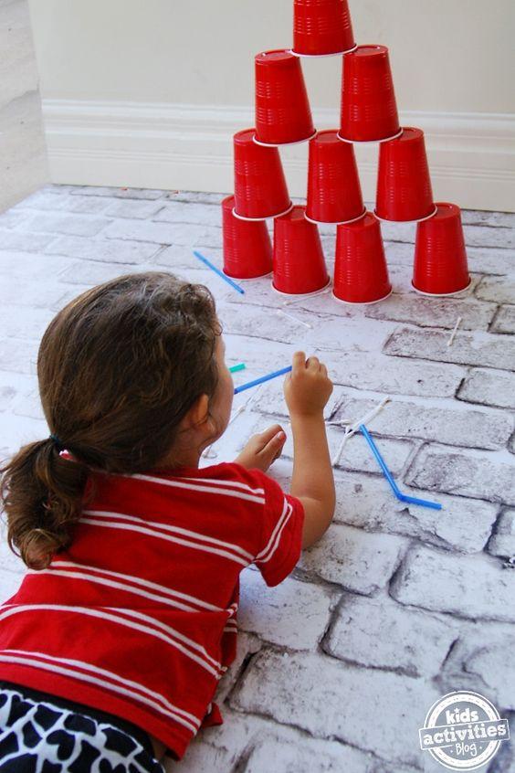 Easy DIY Kids Q-Tip Blow Dart Game - Blow Q-tips through straws in this simple blow dart game via Kids Activity Blog