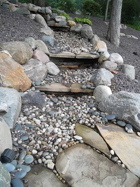waterfall boulders river rock