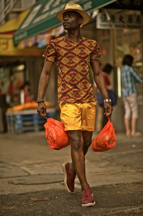 Lougè Delcy wearing an African print straw hat by Brixton, Zara Tee, yellow HM x Marni shorts, Cole Haan Wingtip Espadrilles, Atrium Nixon Watch.    Shot by Koo  Location | Chinatown, New York: