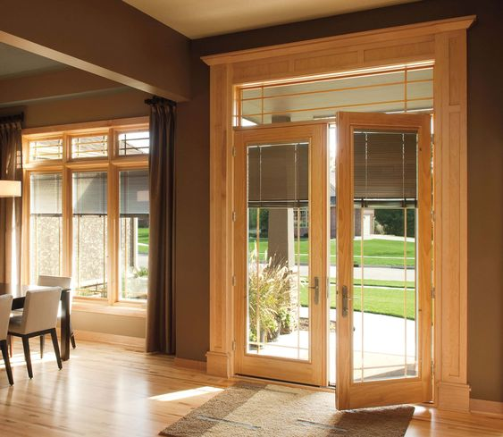 Pella Designer Series hinged patio doors offer innovative betweentheglass blinds shades