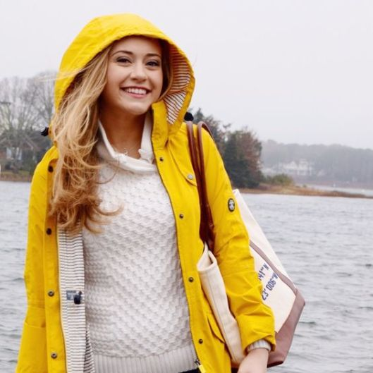 A yellow raincoat is perfect for a preppy outfit!