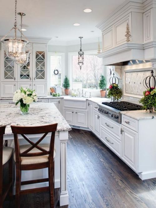 Dream House Marble Countertops Kitchen with White Cabinets and Hardwood Floors Chandeliers Kitchen Island