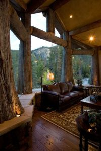 Rustic Living Room with Window seat, Columns, Built-in ...