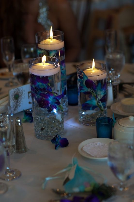 Flower Centerpieces And Peacock Feathers On Pinterest