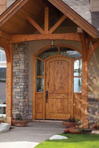 Like Windows Surrounding The Door Timbers On Overhang