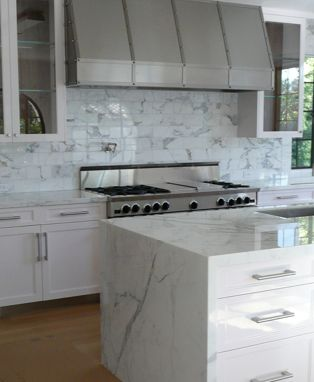 "Carrera marble slab counter top and ""waterfall"". Carrera"