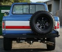Custom built rear bumper with swing away spare tire
