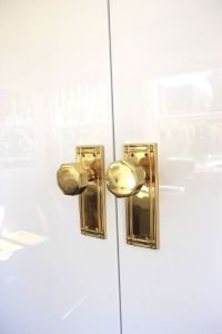 Gold door knobs on white lacquered doors. Love the 70's ...