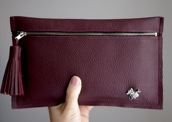 How to make a leather clutch with tassel and embellishment. A DIY step by step tutorial.