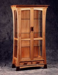 Curio Cabinet: A tall and skinny cabinet with glass doors ...