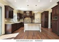 dark wood cabinets with white island.. | Things for my ...