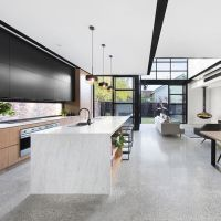 Grey polished concrete floor with black and white ...