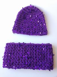 A sparkly hat and infinity scarf set for little girls