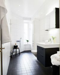 Girls bathroom or guest bathroom, black floor tiles, black