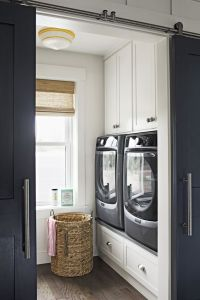 The compact laundry room is super-functional thanks to ...
