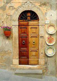 Tuscany...a door with Italian ceramic plates decorating ...