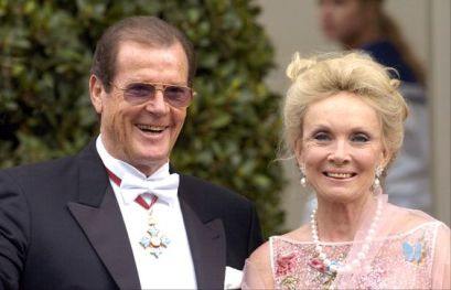 "Roger Moore and Christina ""Kiki"" Tholstrup arrive at Copenhagen Cathedral for the wedding ceremony; wedding of Crown Prince Frederik of Denmark and ms. Mary Donaldson, May 14th 2004:"