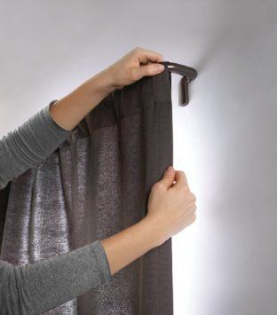 Room darkening curtain rodholds curtains flat against the