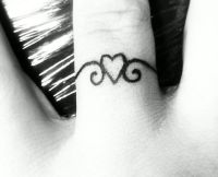 Wedding ring tattoo.....I think this could be incorporated