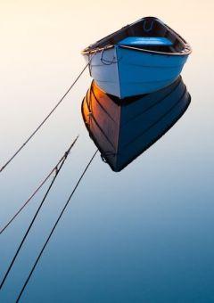The stillness of a blue boat