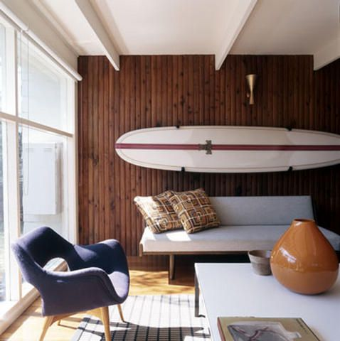 OMG luv the board on the wall and the furniture too cool beach house