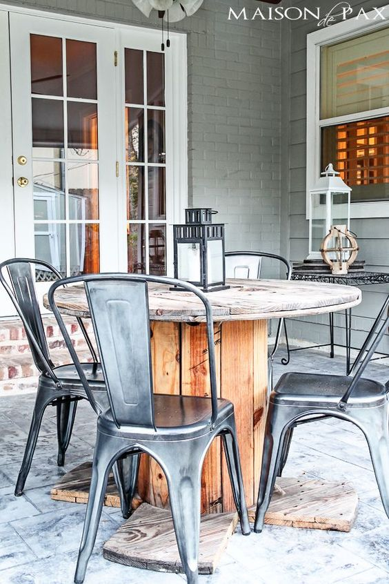 LOvE This combo of industrial chairs and electrical wire spool! Perfect mix. Easiest way to waterproof outdoor wood furniture ever! maisondepax.com: