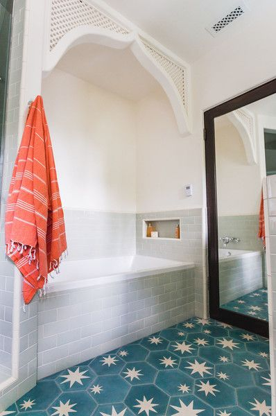 The bold Popham floor tiles in the kid's bathroom instantly transformed what was once a basic bath into a knockout of a space.: