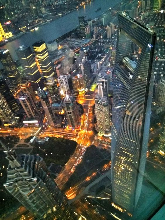 Jin Mao Tower and Shanghai World Financial Center looked from the observatory of Shanghai Tower during the dusk