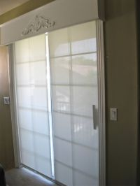 sliding glass door hunter douglas shades and wood cornice ...