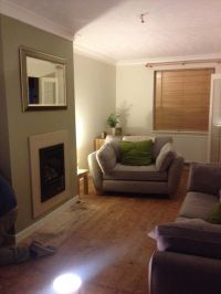 Overtly olive fireplace feature wall. Green Natural Wood ...