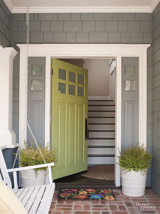 Simply Lovely Gray continues as America's favored neutral. This entryway showcases the color's many attributes: warm grays emit welcoming vibes, complement most colors (including lime green!), and work with styles from classic to contemporary. This porch gained extra points and pins for its geometrically pleasing mix of horizontal cedar shingles, vertical-paneled sidelights, and interestingly patterned brick floors.: