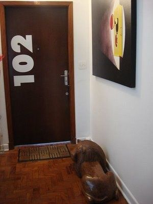 A cute idea for apartment or condo dwellers unit number painted vertically on the door  For