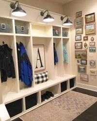 Farmhouse mudroom with built-in lockers, barn light wall ...