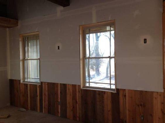 Natural grainy wood half wall paneling