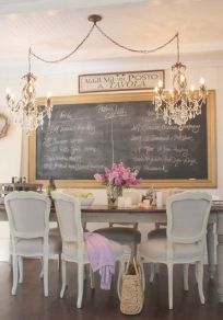 Interesting shabby chic dining room. Chalkboard would definitely keep the young…: