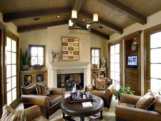 Warm Inviting Living Room A beautiful fireplace and fullybeamed cathedral ceiling warm up