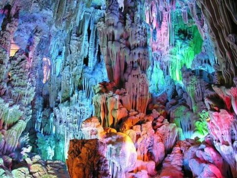 The Reed Flute Cave is a landmark and tourist attraction in Guilin, Guangxi, China. It is a natural limestone cave with multicolored lighting and has been one of Guilin's most interesting attractions for over 1200 years. It is over 180 million years old.: