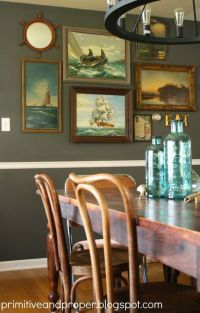 vintage nautical painting gallery wall in a dining room ...