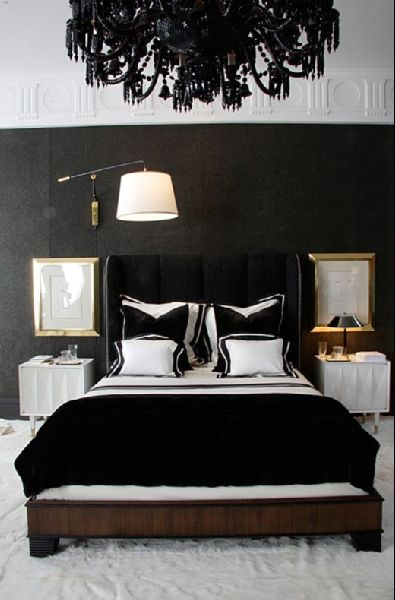 Talk about a statement chandelier Black and white bedroom with a glamorous Hollywood Regency