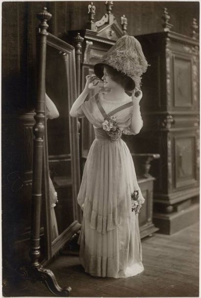 Circa 1910 lady in a fashionable dress and hat.: