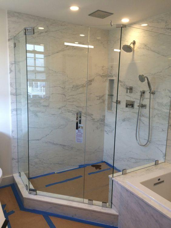 Frameless neo angle shower enclosure with no header