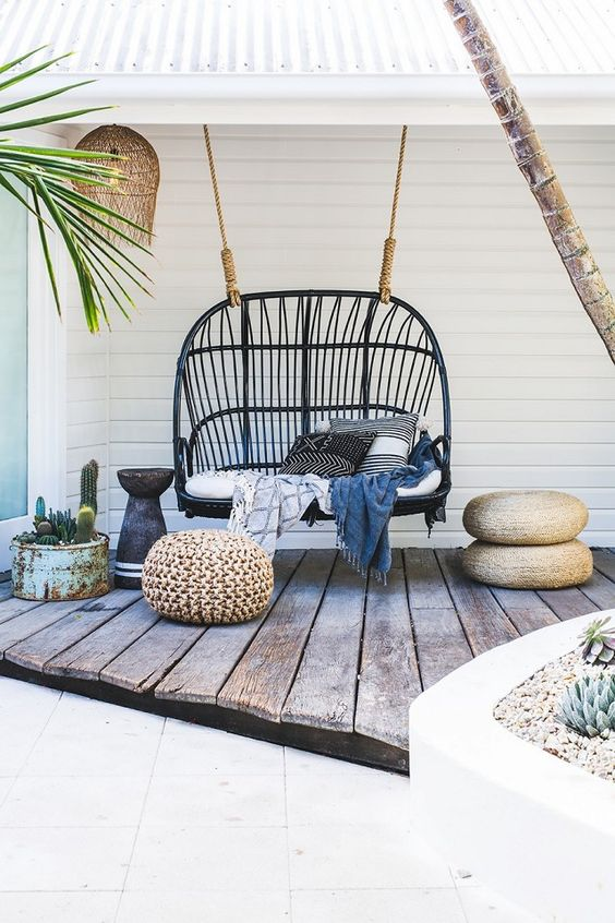 Bohemian inspired outdoor space with a hanging chair: