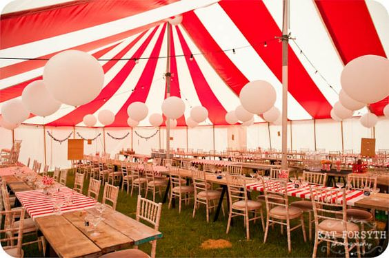 Striped wedding tent for a carnival circus wedding theme by Kat Forsythe Photography.: