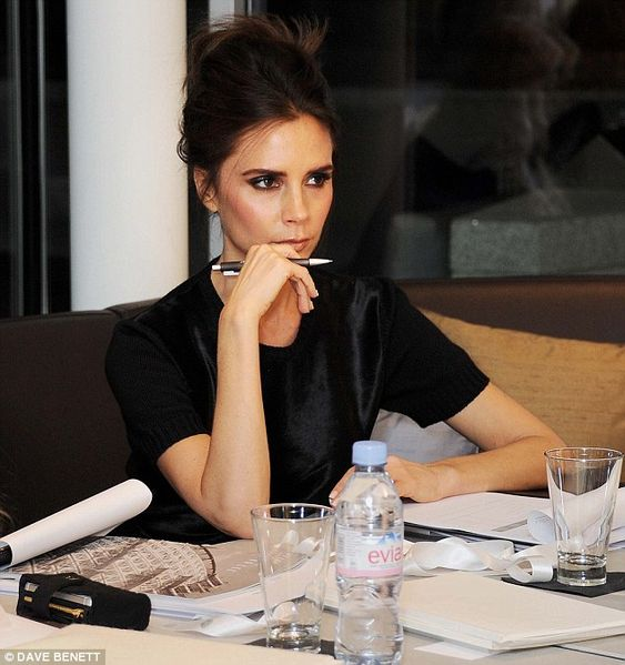 Did someone say pose? Victoria Beckham looks like a mannequin as she judges the 2013 International Woolmark Prize Final: