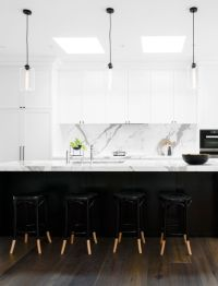 Black and white kitchen: white marble benchtops and ...