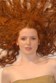 redhead with long curly hair