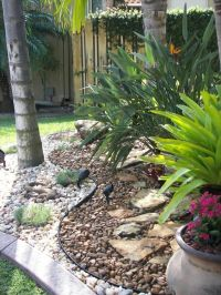 Rock Garden Landscape, great idea, with plants in pots in