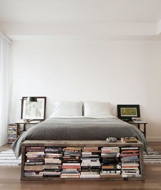 books under a bench at the foot of a bed / sfgirlbybay: