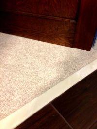 Wood tile floor with marble threshold. Black or dark gray ...