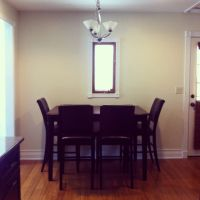 saving room by pushing the dining table against the wall n ...